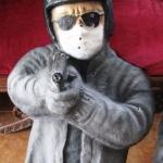 Helmet man with bullet holes